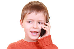 Talking on cellphone. Five years old boy talking on cellphone isolated on white stock photo