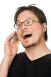 Talking on cellphone. A man using a cell phone on a white background stock images