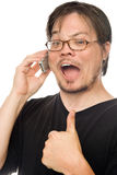 Talking on cellphone. A man using a cell phone on a white background royalty free stock photo