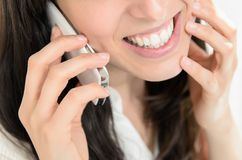 Talking by cellphone intimately Stock Photo