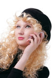 Talking on a cellular phone. Pretty blonde is talking on a cellular phone Stock Images