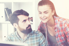 Talking colleagues in sunlit office Royalty Free Stock Photography