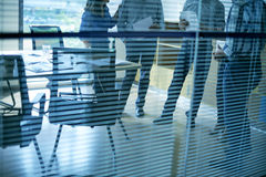 Talking collegues. Cropped image of coworkers talking in office room Stock Image
