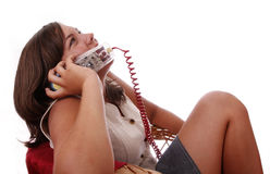 Talking on a colored telephone Royalty Free Stock Photo