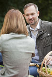 Talking couples by picnic Stock Images