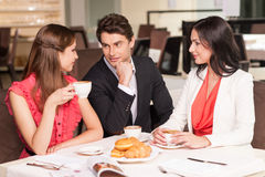 Talking and drinking coffee Royalty Free Stock Photography