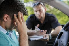 Talking with a driver. Traffic cop is talking with a driver royalty free stock photos