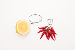 Talking food: lemon and chili peppers with comic labels Royalty Free Stock Photos