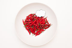 Talking food: red hot chili peppers with label. Talking food: heap of red hot chili peppers in white plate and white background with label Stock Photography