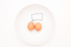 Talking food: two eggs with comic label. Talking food: relationship of two eggs with blank comic label in plate Royalty Free Stock Image