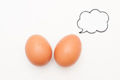Talking food: two eggs with comic label. Talking food: relationship of two eggs with blank comic label on white Royalty Free Stock Image