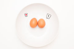 Talking food: two eggs with comic labels Royalty Free Stock Photos