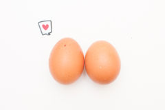 Talking food: two eggs with love comic label. Talking food: relationship of two eggs with red heart comic label on white Royalty Free Stock Photography