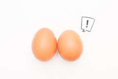 Talking food: two eggs with love comic label. Talking food: relationship of two eggs with red heart comic label on white Stock Image