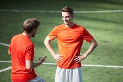 Talking on football field stock photo