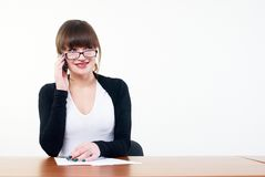 Talking girl by mobile Royalty Free Stock Image