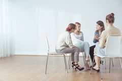 Talking in group Stock Images