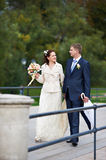 Talking about happy Bride and groom Royalty Free Stock Image