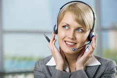 Talking by the headset Stock Photography