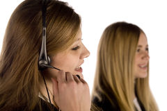 Talking on headset two women Stock Photography