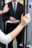 Talking Jehovah's witness to leave her house Royalty Free Stock Images