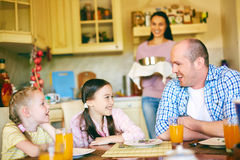 Talking in the kitchen Royalty Free Stock Photos