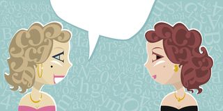 Talking Ladies. With random letters background and speech balloon Royalty Free Stock Photo