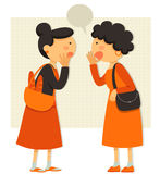Talking ladies. Two women sharing gossip or rumors Stock Photography