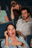 Talking Loudly In A Theater Stock Photos