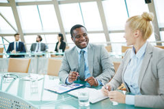 Talking at meeting Stock Images