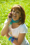 Talking on a mobile phone Royalty Free Stock Photography