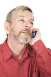 Talking on a mobile phone. Senior talking on a mobile phone royalty free stock photo