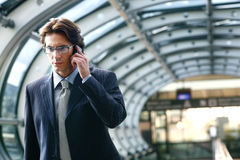 Talking on mobile phone in airport Royalty Free Stock Photos