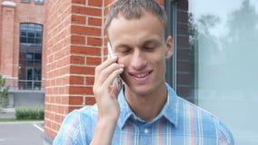 Talking on Mobile Phone. Creative designer , businessman stock footage