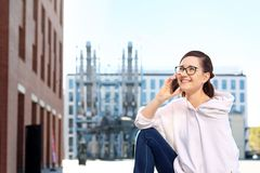 Talking on a mobile phone. Happy, smiling young woman talking on the phone stock images