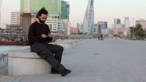 Talking on mobile phone at park stock footage