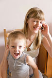 Talking mother and angry son Royalty Free Stock Images