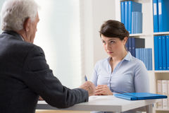 Talking about a new job. Young women talking to a manager about new job Royalty Free Stock Images