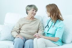 Talking with old patient Stock Photography