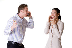 Talking over the phone. Two colleague talking over the phone Royalty Free Stock Image