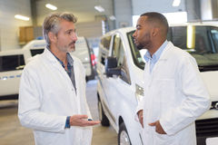 Talking in parking area Royalty Free Stock Image