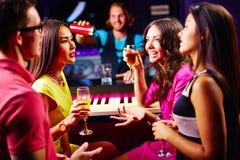 Talking at party Royalty Free Stock Photo