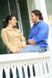 Talking On The Patio. Couple talking on patio in front of their house stock photography