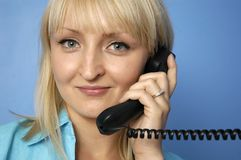 Talking by phone. Woman Stock Image