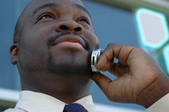 Talking on the phone. Young man talking business on his cell phone Stock Image
