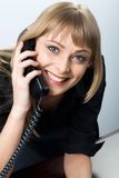 Talking by the phone Stock Photography