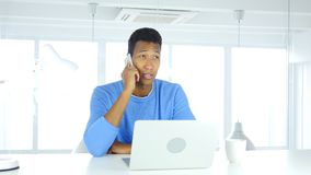 Talking on Phone, Attending Call at Work. 4k , high quality Stock Photography