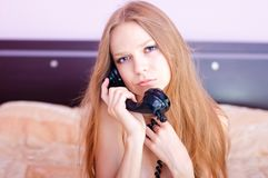 Talking by the phone in a bedroom Royalty Free Stock Images