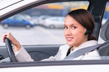 Talking phone in a car using a headset Royalty Free Stock Image
