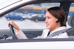 Talking phone in a car using a headset Stock Photography
